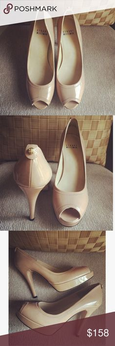 Stuart Weitzman Heels  Designer: Stuart Weitzman. Style: Leather heels with small gold SW emblem on back. Color: Shiny Nude. Heels: 4 1/2 inches. Condition: Used / Good. Purchased at Saks Fifth Avenue. Shoes Heels