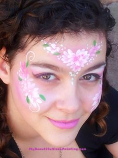 Valentine's heart face painting mask.  DFX white and Tag pink and green. Buy the face paints used in this design from:  http://www.facepaintingtips.com/