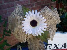 Gerbera daisy and burlap details for pew caps, chair backs, doorways, whatever...