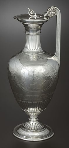 A VICTORIAN SILVER AND SILVER GILT WINE JUG. John, Edward, Walter & John Barnard, London, England, 1871-1872.