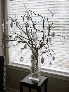A modern Christmas tree! Spray paint white, decorate with lime green,pink,turquoise and orange ornaments !!!