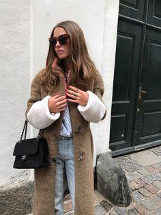 Sophia Roe wearing Saks Potts coat.