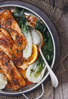 Spicy Orange Roasted Salmon with Bok Choy by seasonsandsuppers: One baking sheet and 15 minutes in the oven is all you need to enjoy this delicious spicy orange salmon with roasted bok choy dinner. #Salmon #Orange #Bok_Choy #Healthy