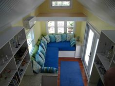 st-george-island-tiny-house. great pics of the interior spaces and great idea making a sectional sitting area using two twin beds - extra sleeping space!