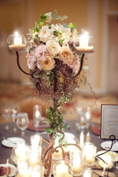NOT my work but something like this for candleabra?! With twigs and foliage running down... obvs on the silver candleabra I have with dinner candles