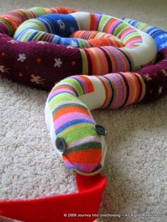 Outgrown tights into cuddly snake.