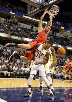 Jonas Valanciunas of the Toronto Raptors dunks the ball during the NBA game against the Indiana Pacersat Bankers Life Fieldhouse on November 2012 in Indianapolis, Indiana. Basketball Is Life, Basketball Legends, Basketball Uniforms, Basketball Teams, Toronto Raptors, Bankers Life Fieldhouse, Kyle Lowry, Indiana Pacers, Wnba