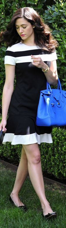 Who made Emmy Rossum's black stripe dress and blue handbag that she wore in West Hollywood on April 16, 2014?
