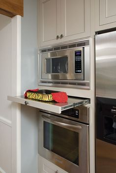 custom.. must have between a microwave and a wall oven = a stainless steel wrapped shelf