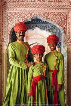 India, Jaipur, Samode Palace, father and sons in ornate hallway https://www.facebook.com/nikhaarfashions