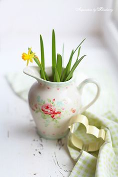 Floral pitcher with flowers.