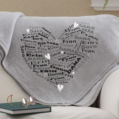 Super soft sweatshirt blanket is personalized with up to 8 loved one's names printed in a repeating fashion in a cute heart shape.  $39.95