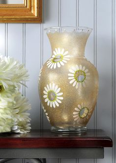 If you want to make something for spring that is fun, glittery, and full of daisies, this DIY vase is a perfect craft idea!