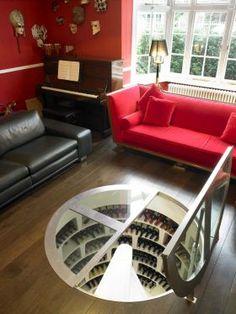 Spiral Cellar With Hinged Round Glass Trap Door ... wow! #luxury #wine #cellar