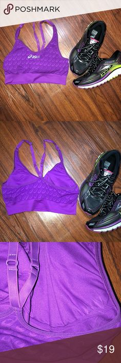 Asics Sports Bra Size medium/large. Has padding and straps are adjustable. Medium support. Padding can be removed. Some unraveling where padding can be pulled out as pictured. Asics Intimates & Sleepwear Bras
