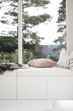 Idea for a cosy corner when having large windows in the living room