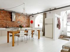 brick + smeg white with wood and res bricks kitchen dining interior design