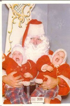 You can always tell a vintage Santa photo from the era of my childhood ~ If in color it's a bit faded, we were always assigned a number visible in the photo like we were in prison, and our Santas were usually pretty darn ugly!