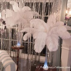 DIY: How To Make Feather Centerpieces | I have used different variations of these DIY ostrich feather centerpieces instead of floral arrangements at all kinds of wedding receptions and parties...a Great Gatsby party, Winter Wonderland party, 50th birthday party, Mardi Gras party, Valentine's Day party...you get the idea :). They are simple to put together and you will save a lot of money making them yourself! Click through to get the step by step instructions.