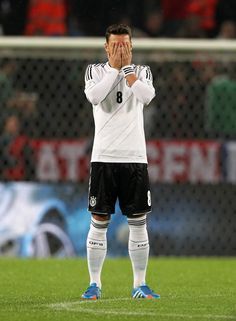 Mesut Ozil prays before the match.