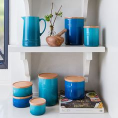 These sleek, colorful canisters come with a tight-sealing beech wood lid that allows for easy stacking on the counter or in cabinets. Air-tight silicone gaskets and a hard-wearing enamel finish make these canisters as functional as they are beautiful. Storage Canisters, Kitchen Canisters, Kitchenware, Marmite En Fonte, Le Creuset Colors, Homemade Trail Mix, Breakfast In Bed, Safe Food, Interior Decorating
