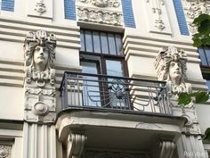 female heads are standing attention on both sides of the balcony Riga Latvia, Female Head, Balcony, Facade, Mansions, Architecture, House Styles, Building, Travel