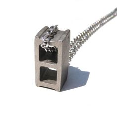 For the builder in you, sport this hip cinderblock necklace by Max Steiner. ($65)    Read more: http://www.dwell.com/slideshows/gift-guide-women.html?slide=13=y=true#ixzz2Elqykzy8