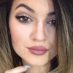 Kylie Jenner. MAC Brave Lipstick or NYX round lipstick in Thalia dupe.