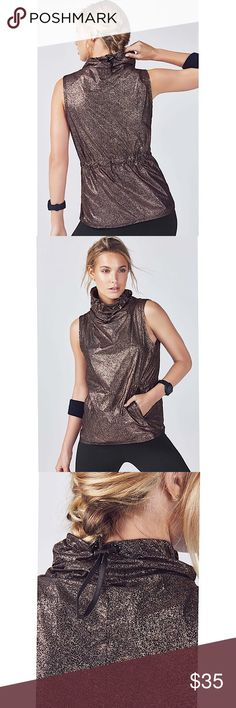 Fabletics LIORA VEST Black Rose Gold Get invested in in-between layering with our essential ripstop vest, designed with a cozy adjustable funnel neck, convenient pockets and a hidden drawcord to customize the silhouette Styling: Lightweight Ripstop Fabric, Hidden Drawcord at Waist, Funnel Neck with Adjustable Drawcord, Welt Zipper Pockets, Pullover Style Lined Quick-Dry Adjustable Zip Pockets Fit: Semi-Fitted Length: Hip Fabletics Jackets & Coats Vests