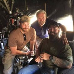 #SOFREP.com ....... Clint Eastwood and Bradley Cooper on the set of American Sniper with former Navy SEAL Elliot Miller. Miller was a former Marine, became a SEAL and was one of my best students in the sniper program. He was hit by an IED blast and is making a good recovery. Clint and Bradley showed nothing but respect and admiration. Thank you to both for taking care of a former teammate.  Special thanks to American Sniper co-writer Scott McEwen for sharing. Brandon Webb