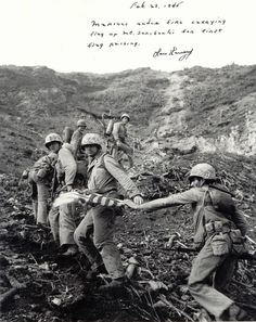 Marines carrying the first flag up Iwo Jima.