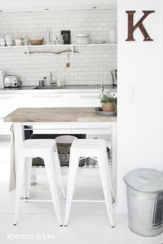 IKEA's Groland kitchen island, painted white  a great hack.