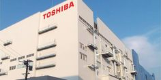 Toshiba signs $18 billion deal to sell off its memory business to Bain lead consortium