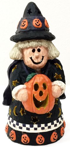 Perfect for your Halloween Decor! Made of sturdy plastic but with the look of realistic wood. Witch has a cute smile and is holding a Jack-O-Lantern. Witch's Hat & Dress has carved out stars and moon Cute Halloween Decorations