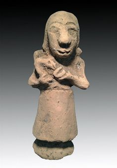 Ancient Mesopotamian Nursing Goddess. Near East, ca. 3200-1900 BCE. A Mesopotamian or Babylonian nursing goddess idol with bird in arms. 6""