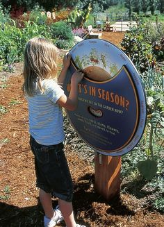 "Commarts - ""The COPIA Kids Garden is an interactive, hands-on learning environment in which children use all of their senses to explore an edible garden. The exhibition design was inspired by the agricultural past of the Napa region; interpretive signage features hand-painted illustrations and bold graphic design that echo fruit labels on produce crates; hay bale benches and a hand-made gardener's shed evoke the vernacular architecture of the region."""
