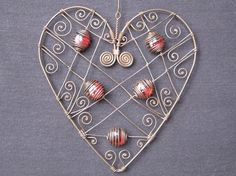 "Wire and bead heart - about 6"" x 6""."