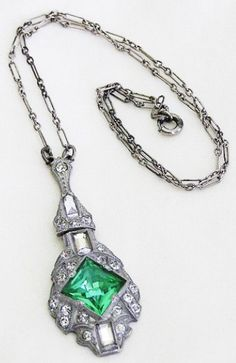 This signed Nov E Line Art Deco pendant necklace is rhodium-plated pot metal with paste, green glass, and a gloriously intricate paperclip chain (my favorite). Via Diamonds in the Library.