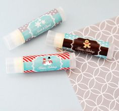 Winter Personalized Lip Balm Tubes. Send off your winter and holiday party guests with a big kiss – or at least the next best thing! These Personalized Winter Lip Balm Tubes are all natural, and infused with organic oils and shea butter. They will surely make your guests feel pampered – this is one favor they won't leave behind! Each lip balm is packaged in a clear glossy tube for a high end spa look. Available in a choice of 3 flavor/color options – Vanilla Ivory...