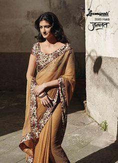 Spun with a charming dose of sauve by Drapping our Chikoo coloured Chiffon Saree beautified with Silver Foil work and beatuiful Printed Lace which adds the glory to the saree. It is also having Satin Cream Coloured Printed Blouse. www.laxmipati.com
