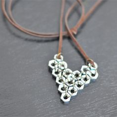 Just in time for Valentine's Day, create this heart-shaped pendant out of hex nuts from your local hardware store.