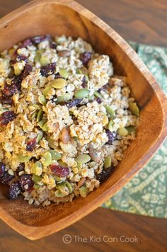 Harvest Granola: Crunchy oats and pumpkin seeds are seasoned with nutmeg, candied ginger and maple syrup. This sweetly spiced base is punctuated by tart cranberries for a delightful flavor contrast. Kids will have fun coating the oat-pumpkin seed mixture with maple syrup in this hearty snack. #KidsCookMonday