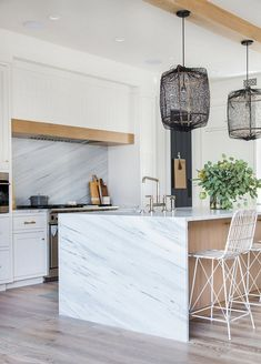 Waterfall kitchen island with white marble Countertop surrounding the kitchen island is White Cherokee Polycor Waterfall kitchen island #Waterfallkitchenisland