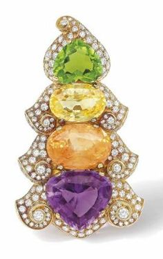 A MULTI-GEM AND DIAMOND CLIP BROOCH, BY BULGARI Centred by a multi-coloured line comprising a heart shaped tourmaline, an oval mixed-cut yellow and orange sapphire and a heart shaped amethyst, within a scrolling pavé-set diamond frame, 1980s