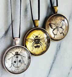 Some of the unique Verre Églomisé pendants I'm now selling on Etsy! https://www.etsy.com/uk/shop/GildedMoonCreations