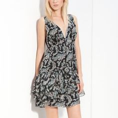 Elizabeth and James Maggie Ikat Tunic 6 NWT Elizabeth and James Maggie Ikat Silk Tunic.  A tiered & ruffled hem offers flirty movement in a printed silk tunic topped with a plunging V-neckline & a tie across the back shoulders.  Fully lined. Side zip. 6 NWT Elizabeth and James Dresses