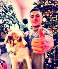 Zac Efron and his Australian Shepherd on their first christmas together.