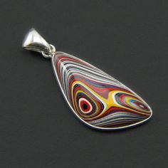 Handcrafted Detroit Fordite Pendant by JewelryDesignsbyLee on Etsy, $80.00