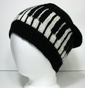 Ravelry: Slouchy Piano Hat pattern by Jennifer Bower OMIGOSH!     I play piano and I love this!    Either I need to learn how to knit now, or adapt thus to a crochet pattern!!