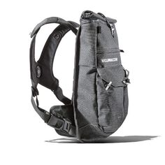 23b3fc334234 Left side view of a medium-sized men s fashion and luxury travel backpack.  Top